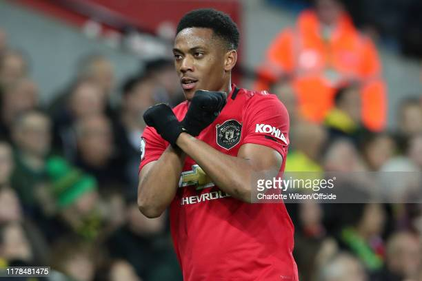 Anthony Martial of Man Utd celebrates scoring their 3rd goal during the Premier League match between Norwich City and Manchester United at Carrow...