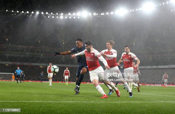 Anthony Martial of Man Utd is challenged Sead Kolasinac Nacho Monreal and Sokratis Papastathopoulos of Arsenal during the Premier League match...