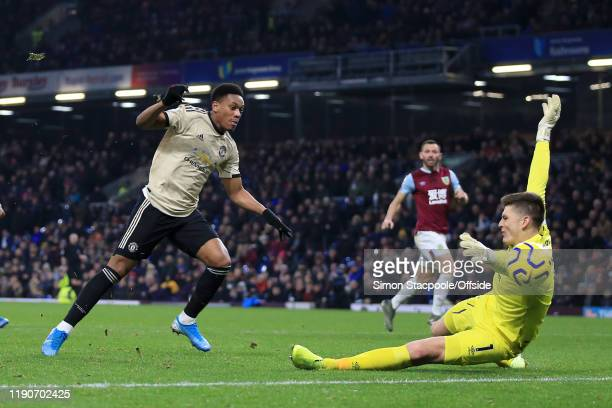 Anthony Martial of Man Utd scores their 1st goal past Burnley goalkeeper Nick Pope during the Premier League match between Burnley FC and Manchester...