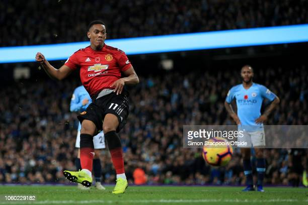 Anthony Martial of Man Utd scores their 1st goal with a penalty during the Premier League match between Manchester City and Manchester United at the...