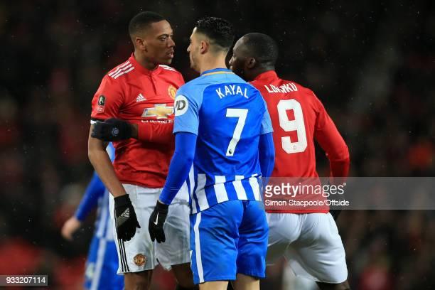 Anthony Martial of Man Utd squares up to Beram Kayal of Brighton as Romelu Lukaku of Man Utd intervenes during The Emirates FA Cup Quarter Final...