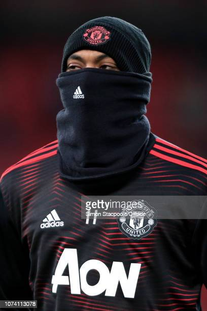 Anthony Martial of Man Utd wears a snood during the warmup ahead of the Premier League match between Liverpool and Manchester United at Anfield on...