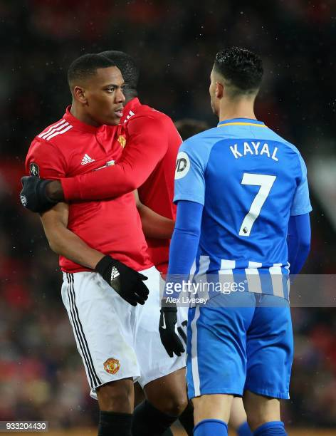 Anthony Martial of Manchester is pulled away from Beram Kayal of Brighton during the Emirates FA Cup Quarter Final between Manchester United and...