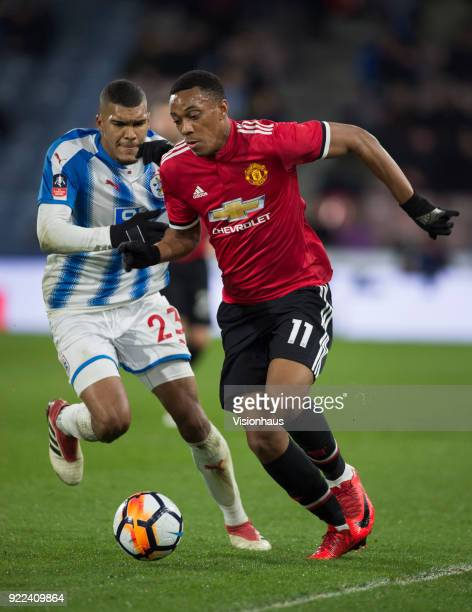 Anthony Martial of Manchester United and Collin Quaner of Huddersfield Town in action during the FA Cup Fifth Round match between Huddersfield Town...