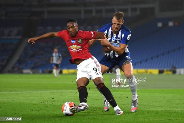 Anthony Martial of Manchester United and Dan Burn of Brighton during the Premier League match between Brighton & Hove Albion and Manchester United at...