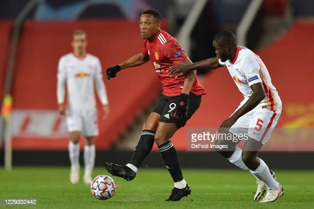 Anthony Martial of Manchester United and Dayot Upamecano of RB Leipzig battle for the ball during the UEFA Champions League Group H stage match...