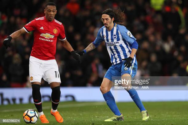Anthony Martial of Manchester United and Ezequiel Schelotto of Brighton Hove Albion during the FA Cup Quarter Final match between Manchester United...