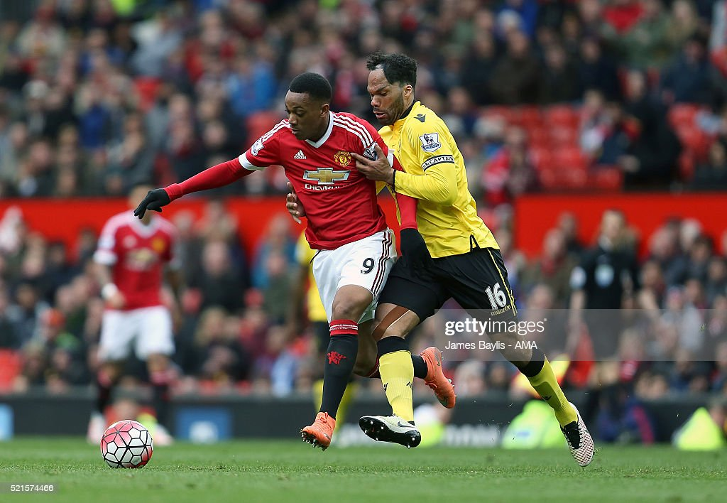 Anthony Martial of Manchester United and Joleon Lescott of Aston Villa during the Barclays Premier League match between Manchester United and Aston Villa at Old Trafford on April 16, 2016 in Manchester, England