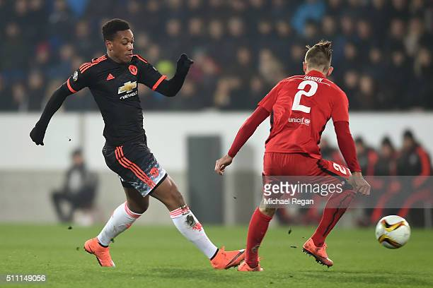 Anthony Martial of Manchester United and Kian Hansen of FC Midtjylland compete for the ball during the UEFA Europa League round of 32 first leg match...
