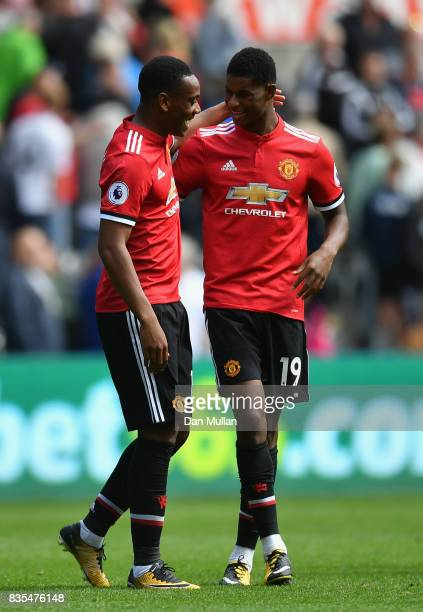 Anthony Martial of Manchester United and Marcus Rashford of Manchester United celebrate victory after the Premier League match between Swansea City...