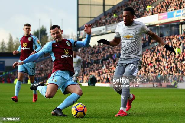 Anthony Martial of Manchester United and Phil Bardsley of Burnley battle for the ball during the Premier League match between Burnley and Manchester...
