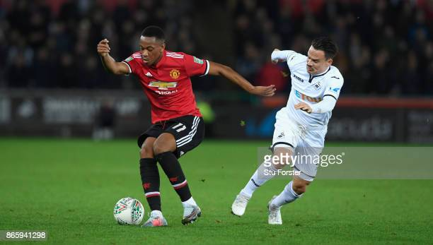 Anthony Martial of Manchester United and Roque Mesa of Swansea City in action during the Carabao Cup Fourth Round match between Swansea City and...