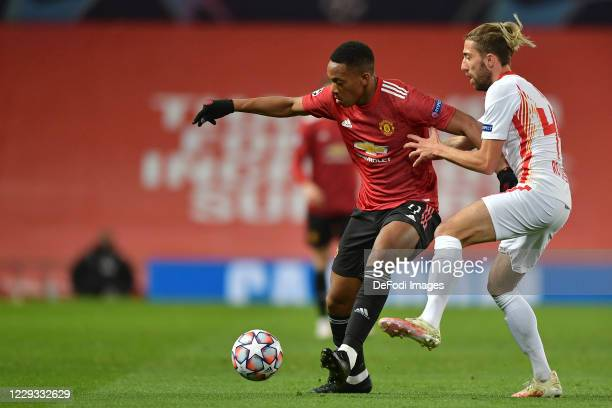 Anthony Martial of Manchester United and Willi Orban of RB Leipzig battle for the ball during the UEFA Champions League Group H stage match between...