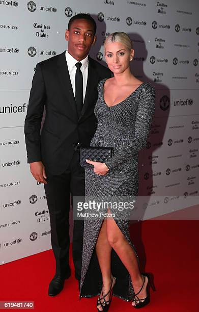 Anthony Martial of Manchester United arrives with his partner at the annual United for UNICEF dinner at Old Trafford on October 31 2016 in Manchester...