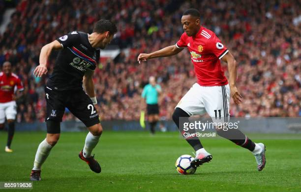 Anthony Martial of Manchester United attempts to get past Joel Ward of Crystal Palace during the Premier League match between Manchester United and...