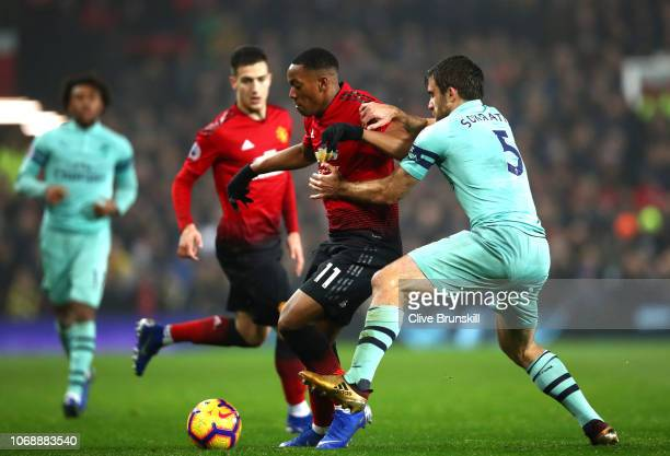 Anthony Martial of Manchester United battles for possession with Sokratis Papastathopoulos of Arsenal during the Premier League match between...