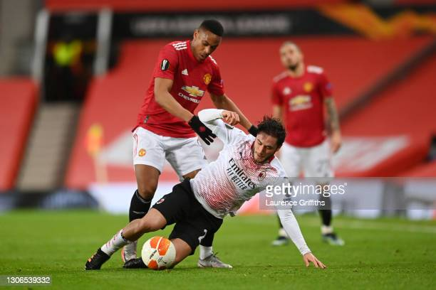 Anthony Martial of Manchester United battles for possession with Davide Calabria of A.C. Milan during the UEFA Europa League Round of 16 First Leg...