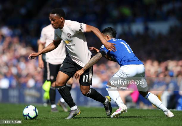Anthony Martial of Manchester United battles for possession with Theo Walcott of Everton during the Premier League match between Everton FC and...