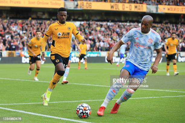 Anthony Martial of Manchester United battles with Nelson Semedo of Wolverhampton Wanderers during the Premier League match between Wolverhampton...