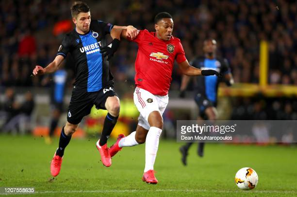 Anthony Martial of Manchester United beats Brandon Mechele of Club Brugge prior to scoring his sides first goal during the UEFA Europa League round...