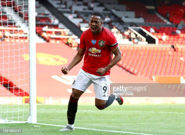 Anthony Martial of Manchester United celebrates after he scores his teams third goal during the Premier League match between Manchester United and...