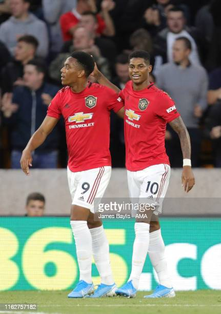 Anthony Martial of Manchester United celebrates after scoring a goal to make it 01 with Marcus Rashford of Manchester United during the Premier...