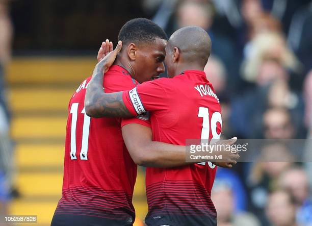 Anthony Martial of Manchester United celebrates after scoring his team's first goal with Ashley Young of Manchester United during the Premier League...