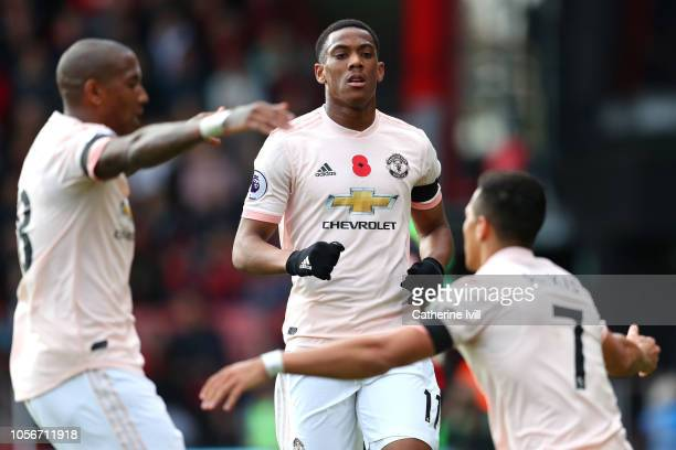 Anthony Martial of Manchester United celebrates after scoring his team's first goal with Ashley Young of Manchester United and Alexis Sanchez of...