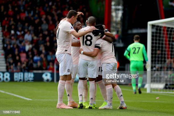 Anthony Martial of Manchester United celebrates after scoring his team's first goal with his Manchester United team mates during the Premier League...