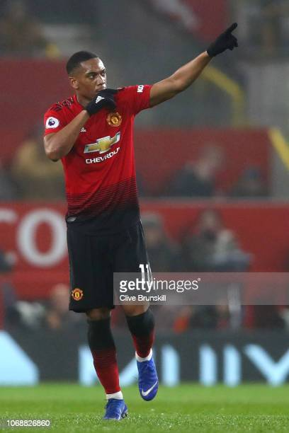 Anthony Martial of Manchester United celebrates after scoring his team's first goal during the Premier League match between Manchester United and...
