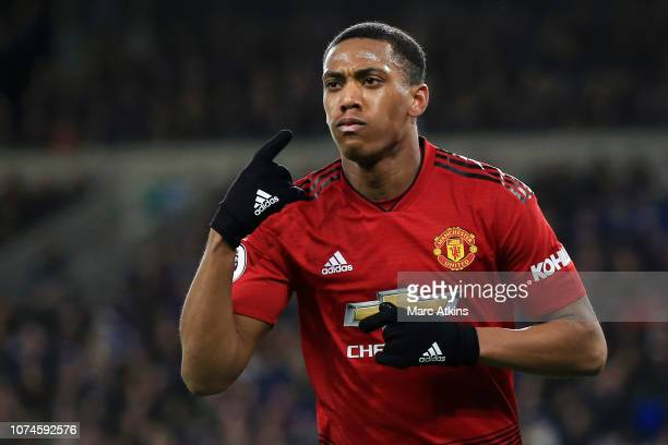 Anthony Martial of Manchester United celebrates after scoring his team's third goal during the Premier League match between Cardiff City and...
