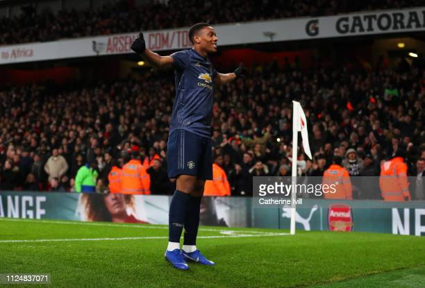 Anthony Martial of Manchester United celebrates after scoring his team's third goal during the FA Cup Fourth Round match between Arsenal and...