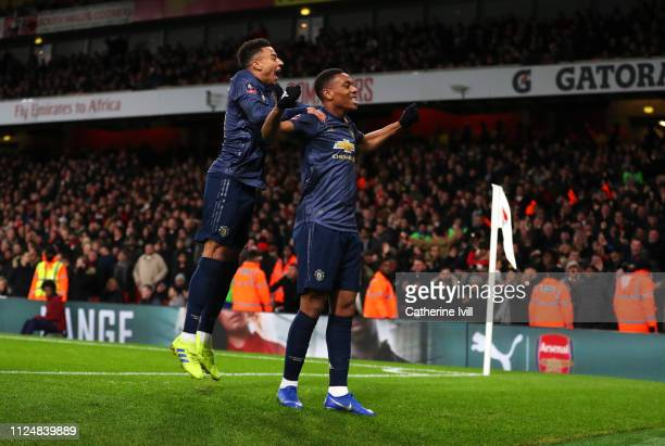 Anthony Martial of Manchester United celebrates after scoring his team's third goal with Jesse Lingard during the FA Cup Fourth Round match between...