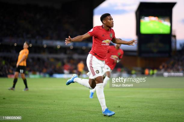Anthony Martial of Manchester United celebrates after scoring his team's first goal during the Premier League match between Wolverhampton Wanderers...