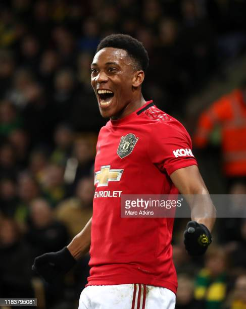 Anthony Martial of Manchester United celebrates after scoring his sides third goal during the Premier League match between Norwich City and...