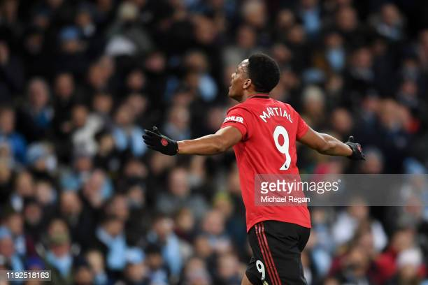 Anthony Martial of Manchester United celebrates after scoring his team's second goal during the Premier League match between Manchester City and...