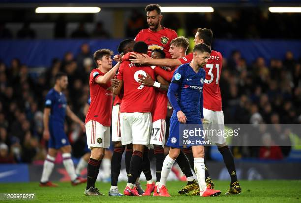 Anthony Martial of Manchester United celebrates after scoring his sides first goal with team mates during the Premier League match between Chelsea FC...