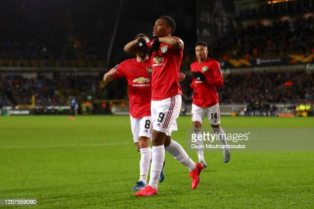 Anthony Martial of Manchester United celebrates after scoring his teams first goal during the UEFA Europa League round of 32 first leg match between...