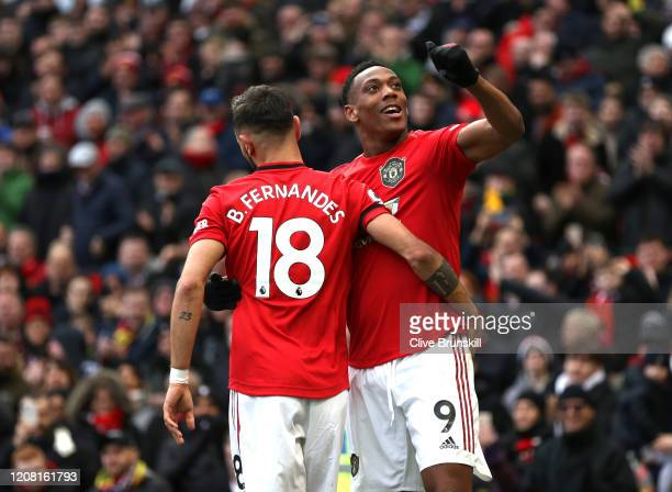 Anthony Martial of Manchester United celebrates after scoring his team's second goal with teammate Bruno Fernandes during the Premier League match...