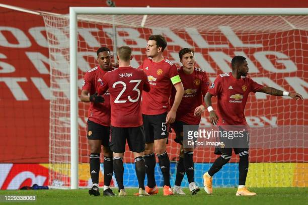 Anthony Martial of Manchester United celebrates after scoring his teams 3rd goal with team mates during the UEFA Champions League Group H stage match...