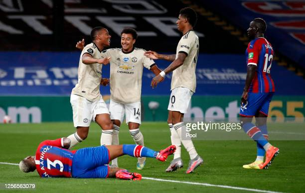 Anthony Martial of Manchester United celebrates after scoring his sides first goal as Patrick van Aanholt of Crystal Palace reacts during the Premier...