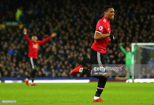 Anthony Martial of Manchester United celebrates after scoring his sides first goal during the Premier League match between Everton and Manchester...