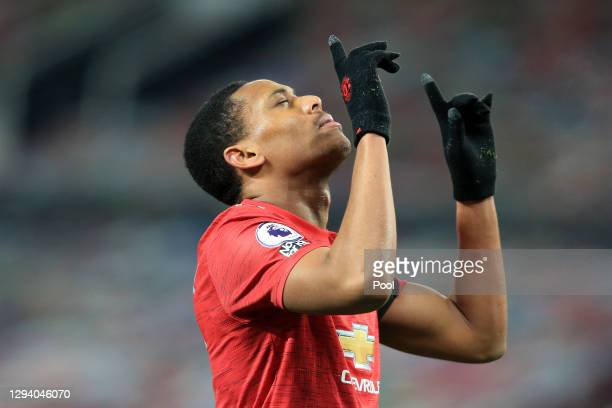 Anthony Martial of Manchester United celebrates after scoring their team's first goal during the Premier League match between Manchester United and...
