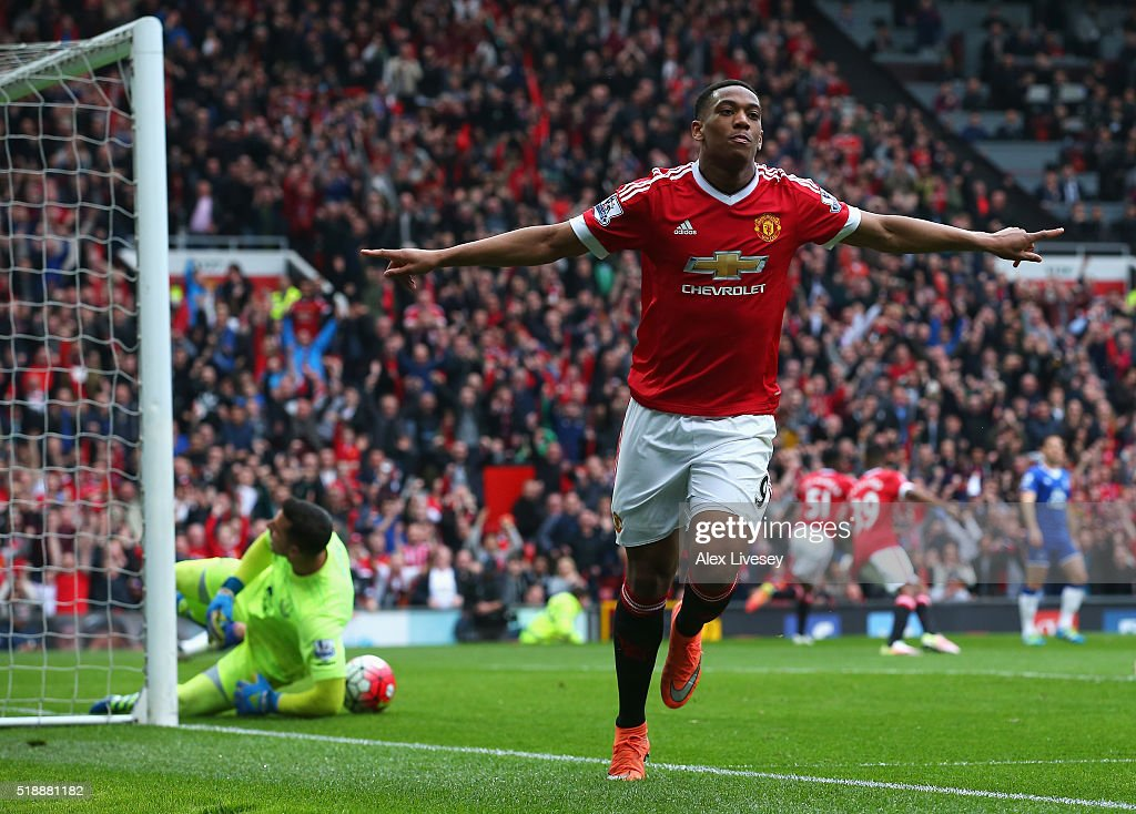 Anthony Martial of Manchester United (9) celebrates as he scores their first goal during the Barclays Premier League match between Manchester United and Everton at Old Trafford on April 3, 2016 in Manchester, England.