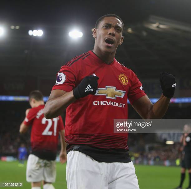 Anthony Martial of Manchester United celebrates Jesse Lingard scoring their fourth goal during the Premier League match between Cardiff City and...