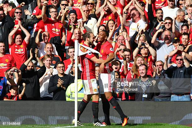 Anthony Martial of Manchester United celebrates scoring his sides first goal with his Manchester United team mate Daley Blind of Manchester United...