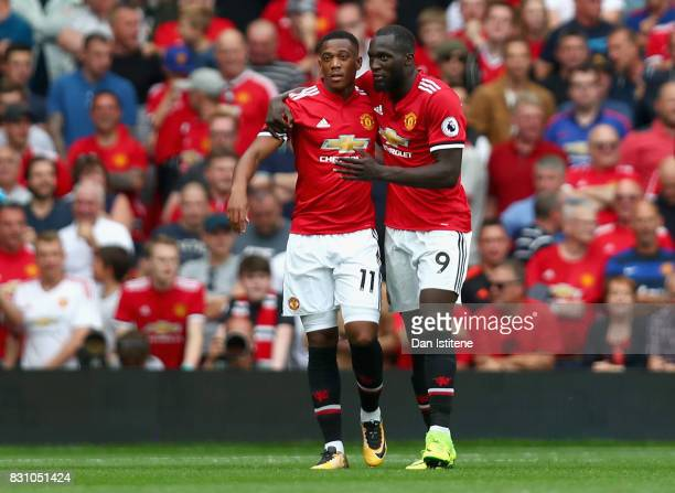 Anthony Martial of Manchester United celebrates scoring his sides third goal with Romelu Lukaku of Manchester United during the Premier League match...