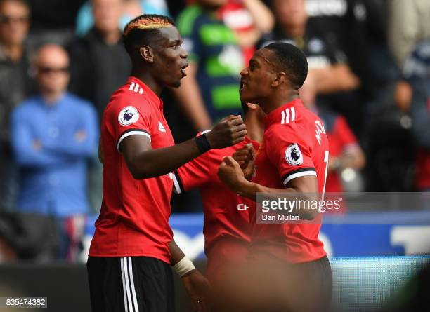 Anthony Martial of Manchester United celebrates scoring his sides fourth goal with Paul Pogba of Manchester United during the Premier League match...