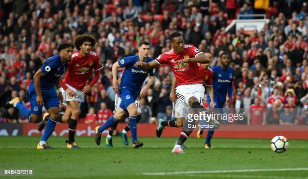 Anthony Martial of Manchester United celebrates scoring his sides fourth goal from the penalty spot during the Premier League match between...