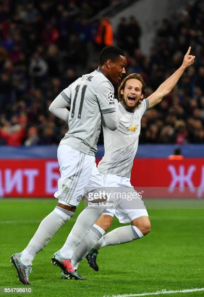 Anthony Martial of Manchester United celebrates scoring his sides second goal with Daley Blind of Manchester United during the UEFA Champions League...